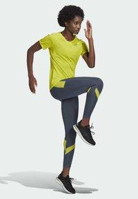 adidas Performance - ADI RUNNER PRIMEGREEN RUNNING - T-shirts - yellow - 2