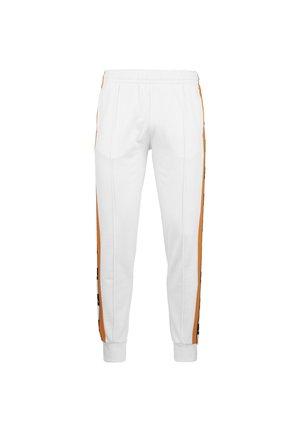 CIOVAN - Tracksuit bottoms - white / orange / black