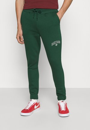 COLLEGE PRINT UNISEX - Tracksuit bottoms - green