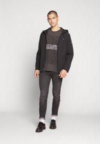 Calvin Klein - CRINKLE HOODED WINDCHEATER - Summer jacket - black - 1
