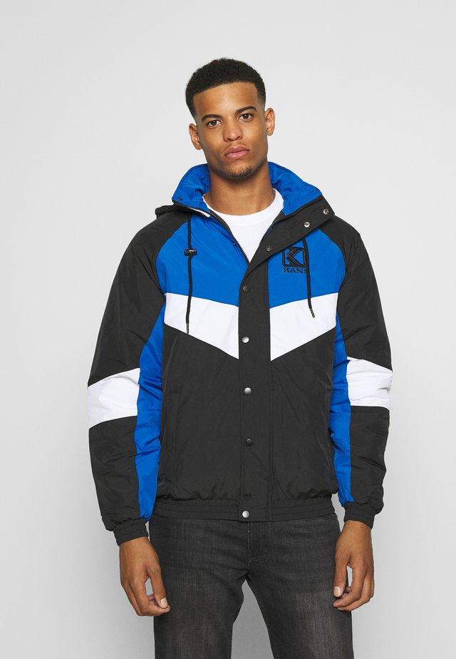 PADDED BLOCK WINDRUNNER - Light jacket - black