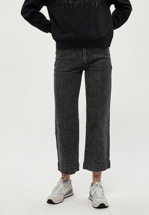 FLORENCE - Flared Jeans - black washed