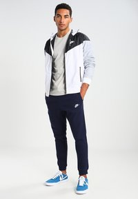 Nike Sportswear - CLUB JOGGER - Tracksuit bottoms - blue - 1