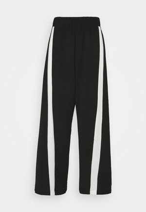 MOMENT PANTS - Trousers - black/white