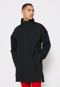 adidas Performance - URBAN RAIN.RDY - Waterproof jacket - black - 0