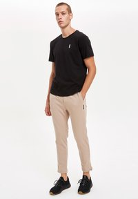 DeFacto Fit - Pantaloni sportivi - beige - 1