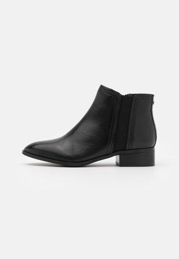 LARECAJA - Ankle boots - black