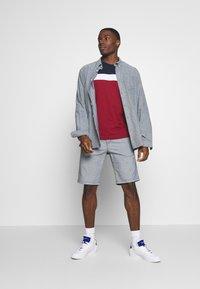 TOM TAILOR DENIM - Shorts - mottled light blue - 1