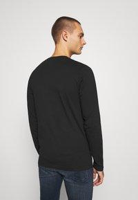 Calvin Klein Jeans - ESSENTIAL INSTIT TEE UNISEX - Long sleeved top - black - 2