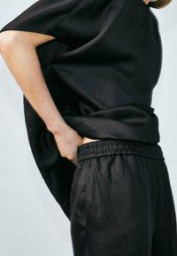 Massimo Dutti - Tracksuit bottoms - black - 0