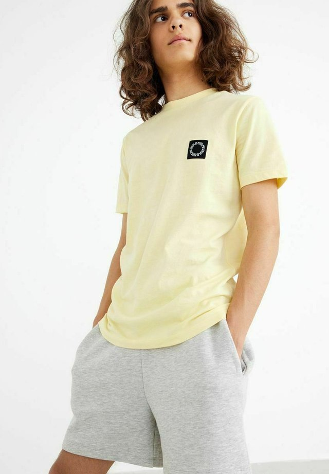 Pantaloni sportivi - light grey melange