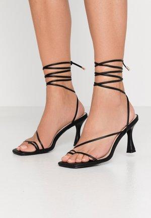 RICHIE - Sandalias de tacón - black