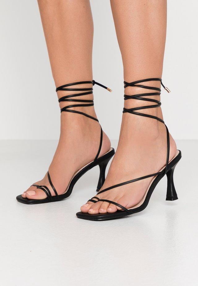 RICHIE - Sandály na vysokém podpatku - black