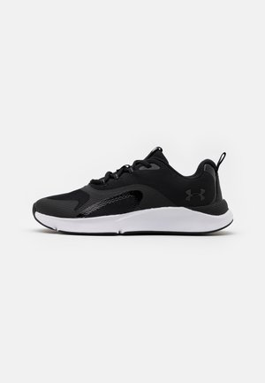 UA W CHARGED RC - Sports shoes - black/white