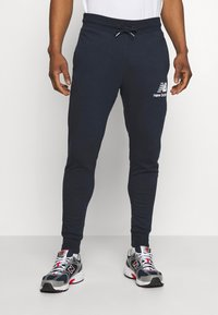 New Balance - ESSENTIAL STACK LOGO  - Tracksuit bottoms - eclipse - 0