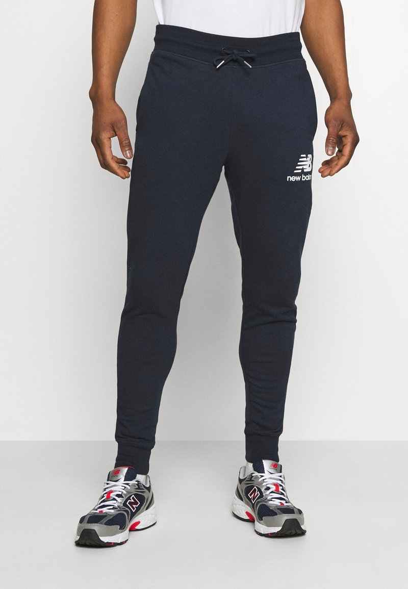 New Balance - ESSENTIAL STACK LOGO  - Tracksuit bottoms - eclipse