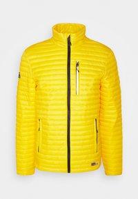 MICRO QUILT PACKAWAY FUJI - Light jacket - bright yellow