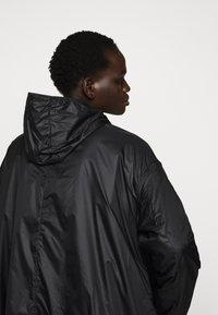 PYRENEX - WATER REPELLENT AND WINDPROOF - Waterproof jacket - black - 5