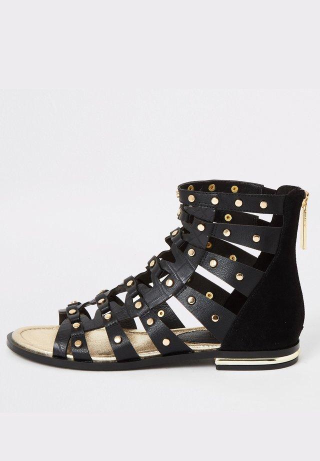 Ankle cuff sandals - black
