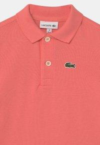 Lacoste - BABY UNISEX - Polo shirt - amaryllis - 2