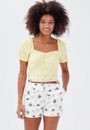 T-shirt print - jaune pastel