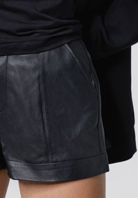Tigha - Leather trousers - black - 3