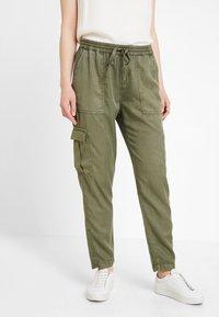 Opus - MUNDINI - Trousers - oliv green - 0