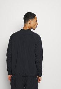 Nike Performance - MIDLAYER CREW - Sports jacket - black/silver - 2