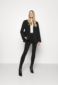 Guess - SEBASTIANA - Leggings - Trousers - jet black - 1