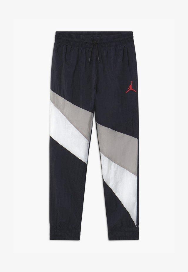JUMPMAN WAVE WIND - Pantaloni sportivi - black