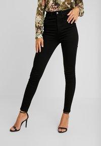 Vero Moda - VMSANDRA - Jeans Skinny Fit - black - 0