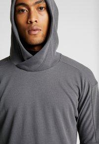 Nike Performance - Jersey con capucha - iron grey/black - 4