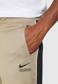 Nike Sportswear - PANT - Verryttelyhousut - khaki/black/white - 4