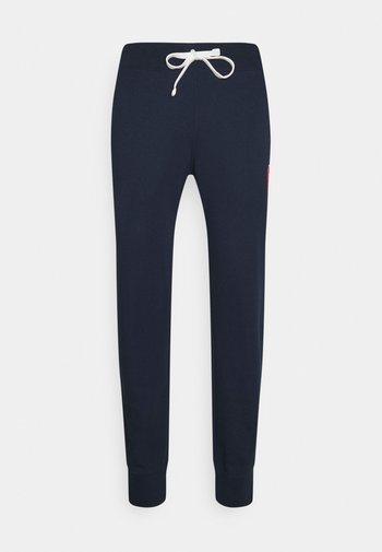 CUFF PANTS - Tracksuit bottoms - dark blue