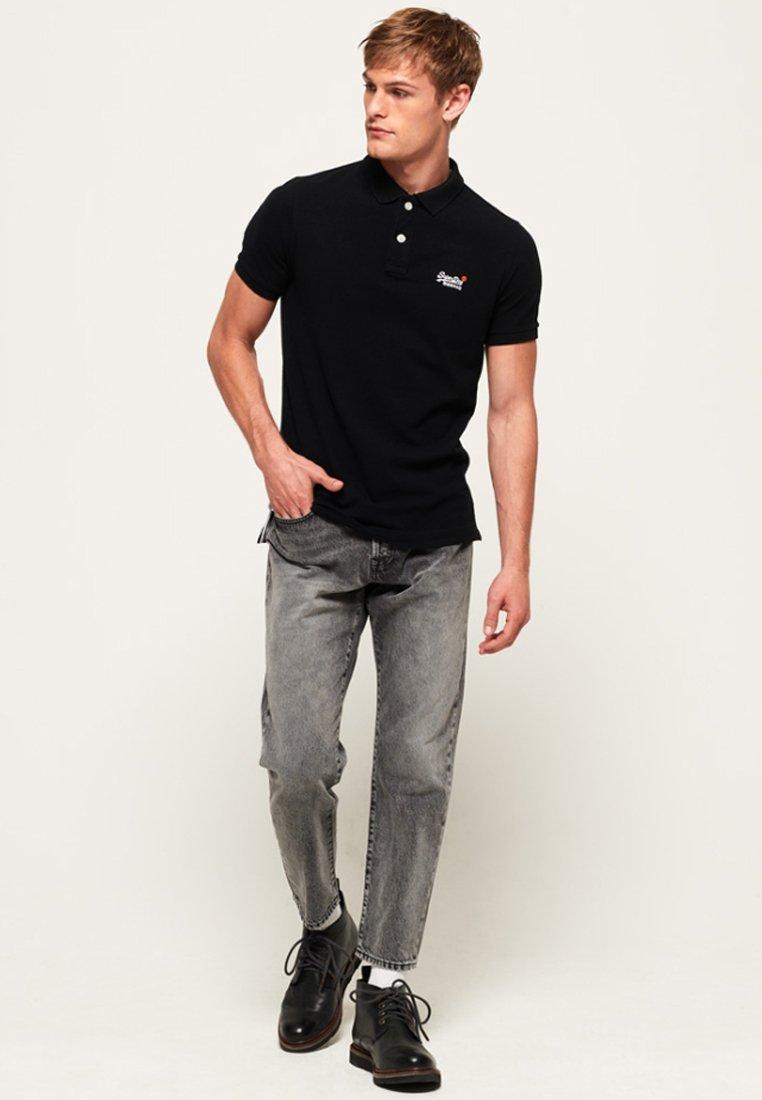 Superdry MIT KURZEN ÄRMELN - Poloshirt - black/schwarz zJo4Qi