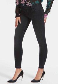 "Guess - ""A$AP ROCKY"" - Jeans Skinny Fit - schwarz - 0"
