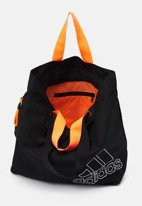 adidas Performance - TOTE - Sportovní taška - black/white - 3
