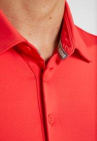 adidas Golf - Funkční triko - real coral/white - 6