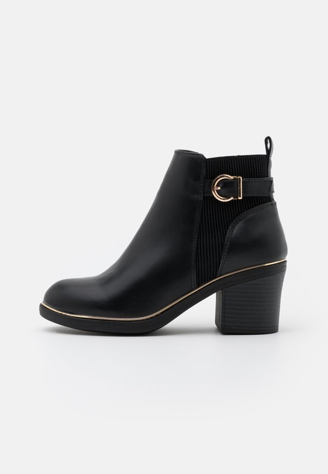 ASHA CHUNKY METAL RAND - Ankle boot - black