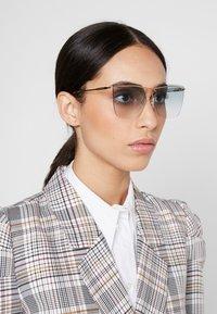 Alexander McQueen - Sunglasses - gold-coloured/blue - 1