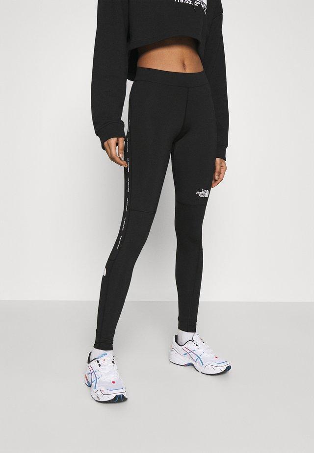 TIGHT - Leggings - black
