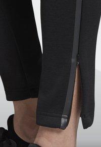 adidas Performance - ADIDAS Z.N.E. TRACKSUIT BOTTOMS - Tracksuit bottoms - black - 6