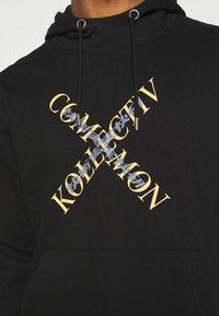Common Kollectiv - SLASH HOOD UNISEX - Sweatshirt - washed black - 5