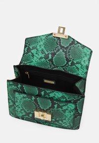 ALDO - SNAKE - Handbag - green - 2