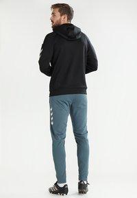 Hummel - TECH MOVE ZIP HOOD - Training jacket - black - 2