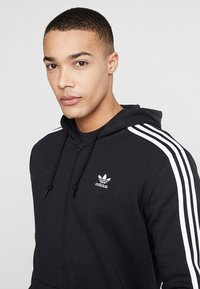 adidas Originals - STRIPES UNISEX - Huvtröja med dragkedja - black - 4