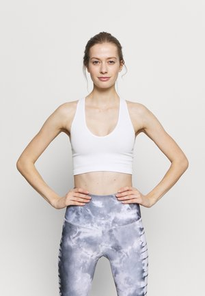 FREE THROW CROP - Light support sports bra - white