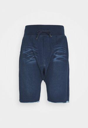 Teplákové kalhoty - washed blue