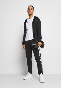 Champion - LEGACY CUFF PANTS - Pantalon de survêtement - black/grey - 1