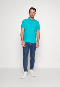 Tommy Hilfiger - REGULAR - Polo shirt - green - 1